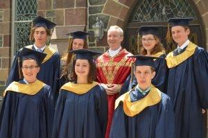 2018-Graduates-w-FrDaniel-300x199.jpg