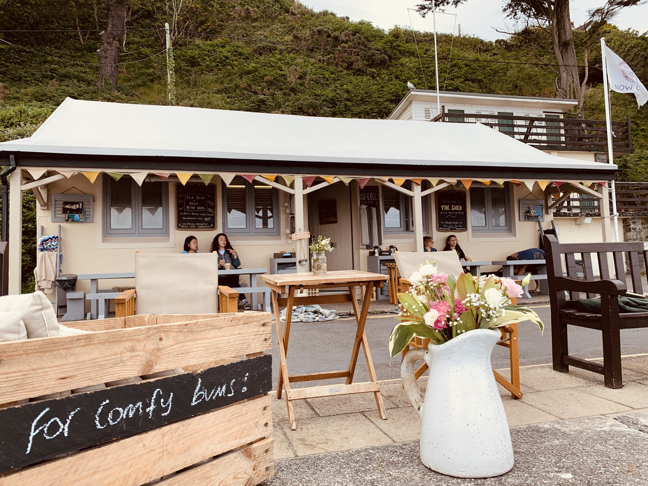 - The Shed in Laxey, Isle of Man, serves seriously good coffee and provides cushions (and cosy blankets in the winter) so that you can relax on the sea-wall to drink it.