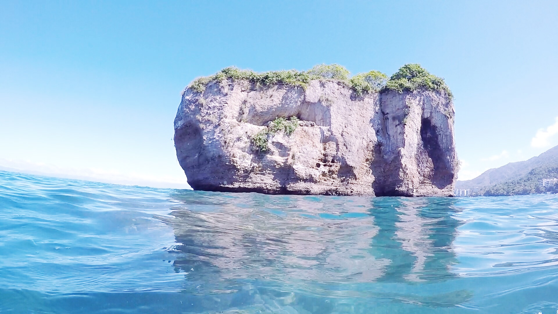 View of one of the islands of Los Arcos from the water.