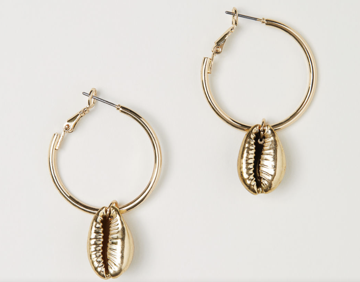 Photo courtesy of H&M   H&M Gold Cowry Shell Hoop Earrings - $5.99