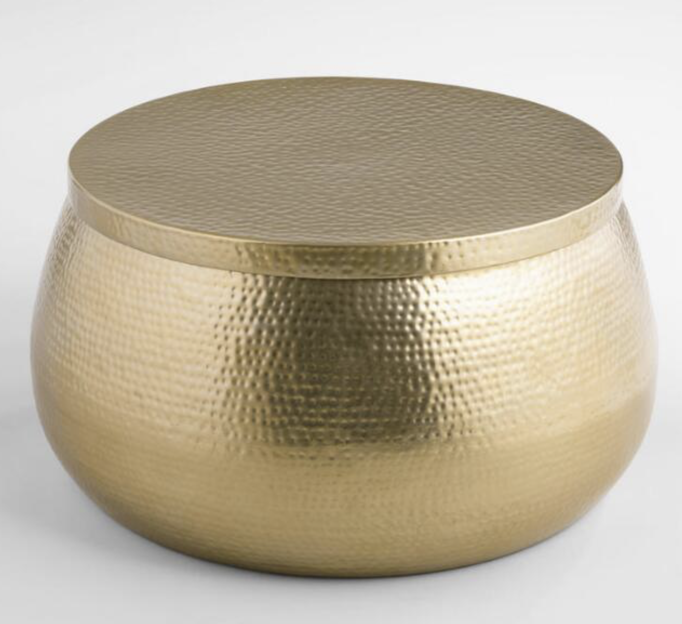 Photo courtesy of World Market   World Market Gold Hammered Metal Cala Coffee Table - $329.99