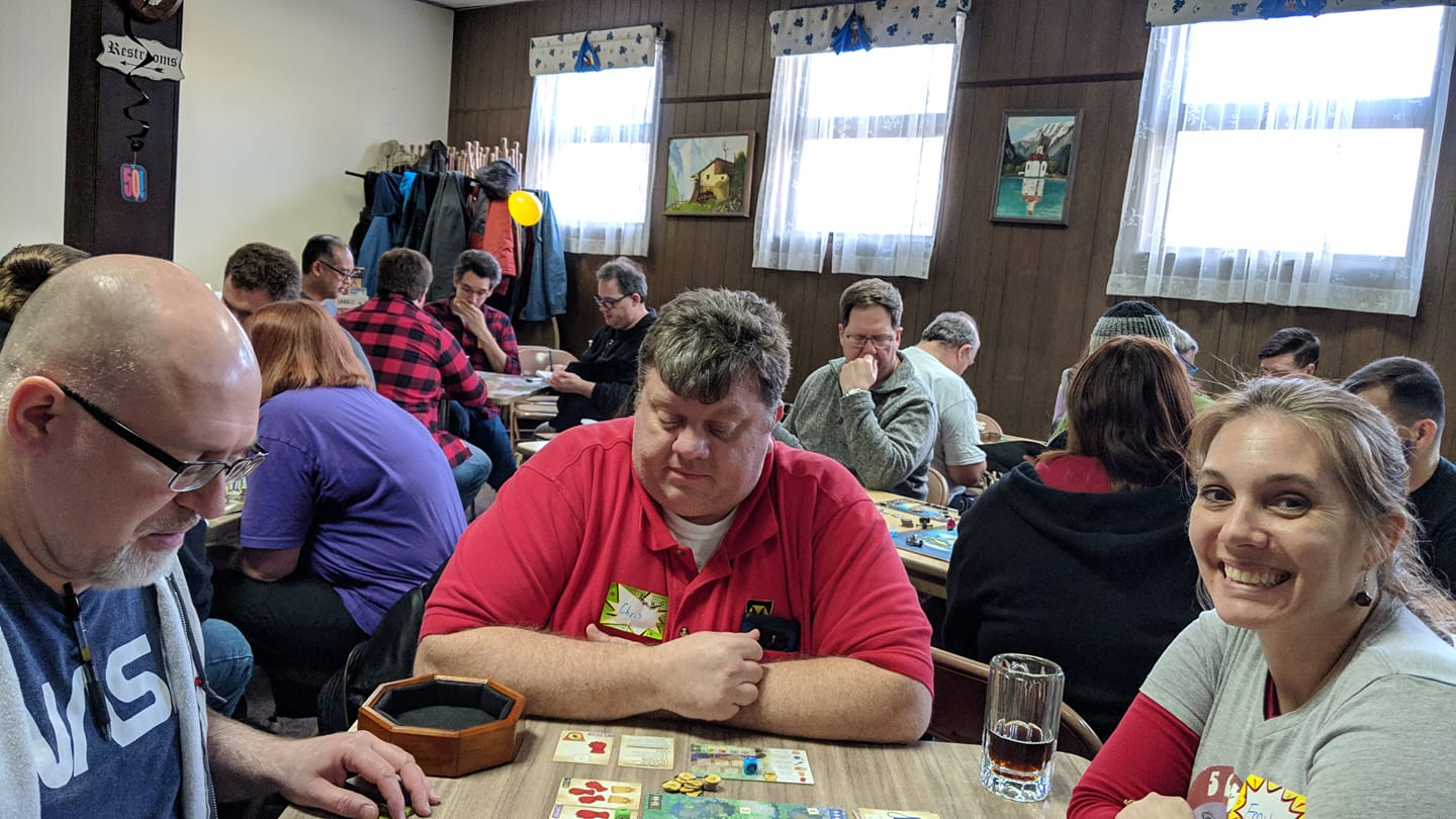 Cindi taught Scott Cozzilio from Epic Loot, Chris Funk and Emily Detmer — Herbacious Sprouts. We recently picked it up and had been playing it a bit. You can see me in the background playing my roll-and-write marathon.