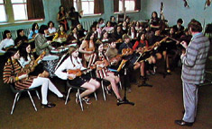 J. Chalmers Doane conducts at a ukulele ensemble rehearsal (c. 1972)