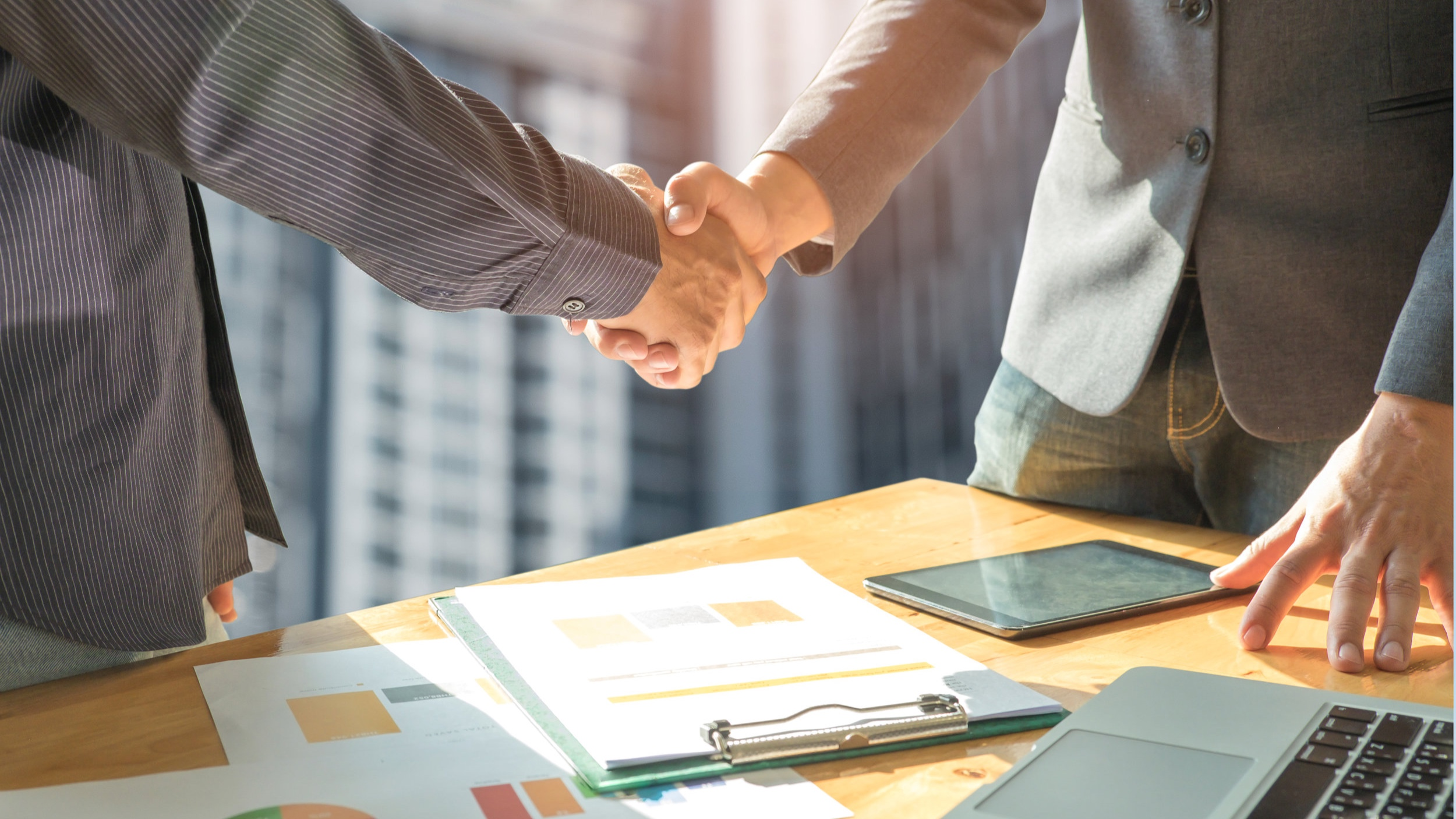 business-concept-two-men-shake-hands-with-P2DZLE6.jpg