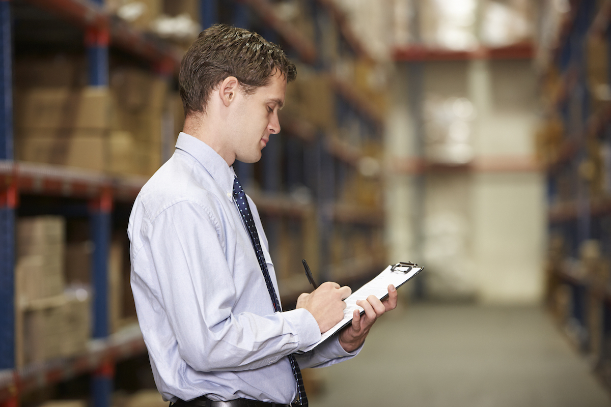 manager-in-warehouse-with-clipboard-PTQK8AH.jpg