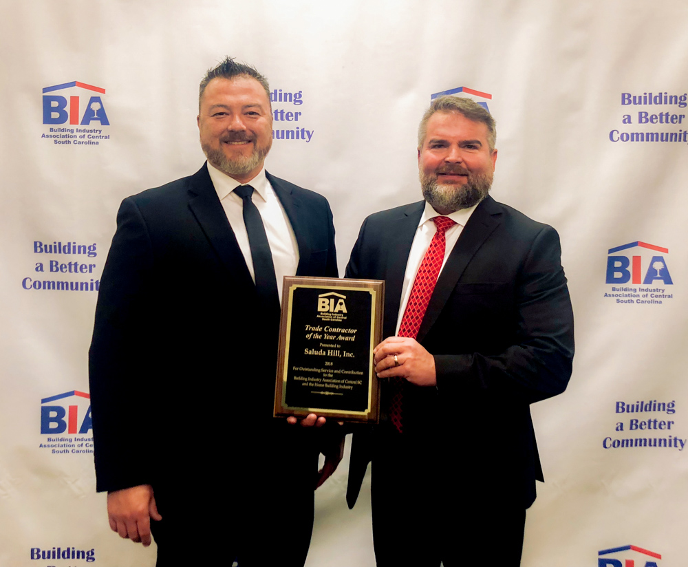 Left to right: Production Landscaping Manager, Eric Fannin and Owner of Saluda Hill Landscapes, Wendell Furtick pictured with Trade Contractor of the Year Award