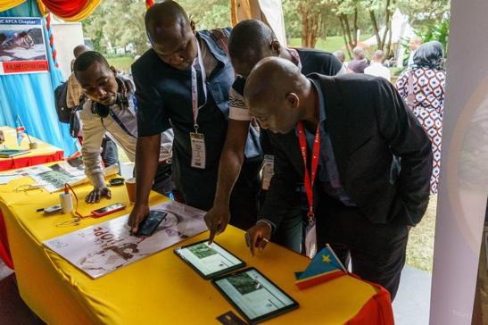 The interactive Congo Coffee Atlas demonstration puts the power of the tool and information in your hands. Pictured here, visitors at the African Fine Coffees Association (AFCA) Conference in 2018 are test driving the tool on tablets, filtering based on interests, and realizing the its utility for themselves.