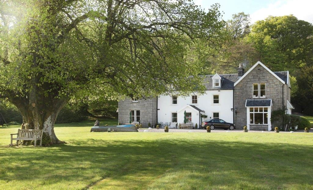 The stunning Kilcamb Lodge boasts a private loch so dogs can run around safely!