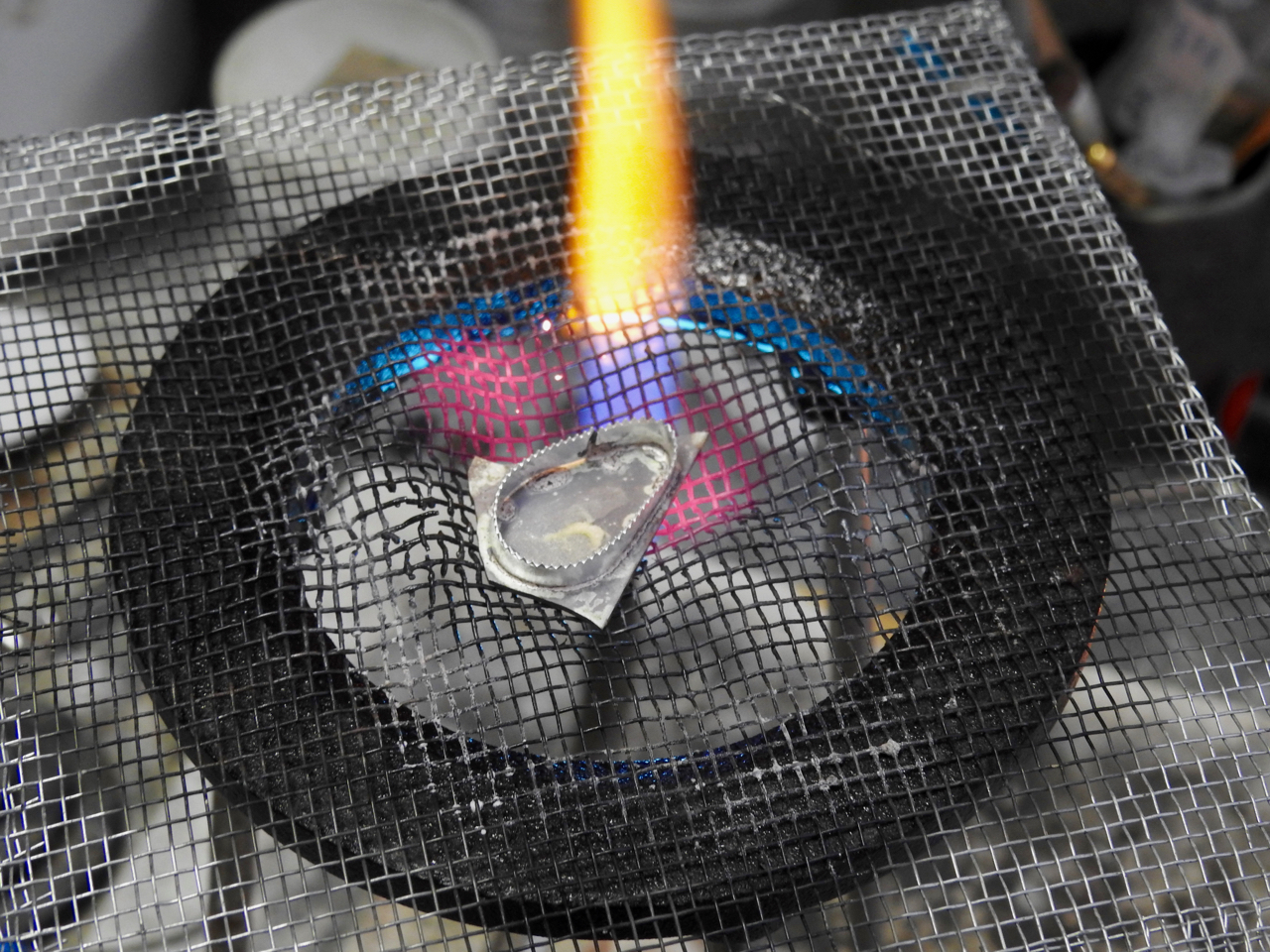 solder bezel to backplate