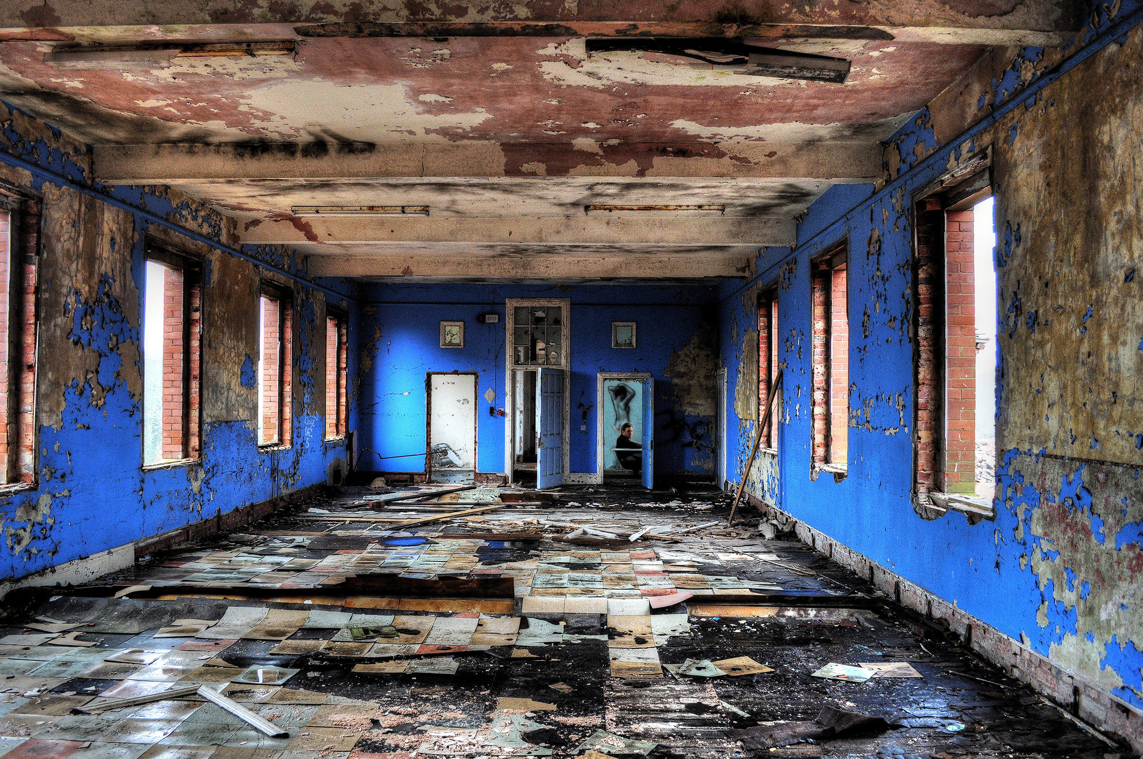 Hellingly Asylum - This one was pretty destroyed by the time I got there.I was obsessed with this room with the bathtub.The undulating multicoloured floor tiles were spectacular and the one peely blue door into the room was beautiful.This place housed 10,000 inmates at its best. A fully working.self sustaining village for the outcasts and unwanted.