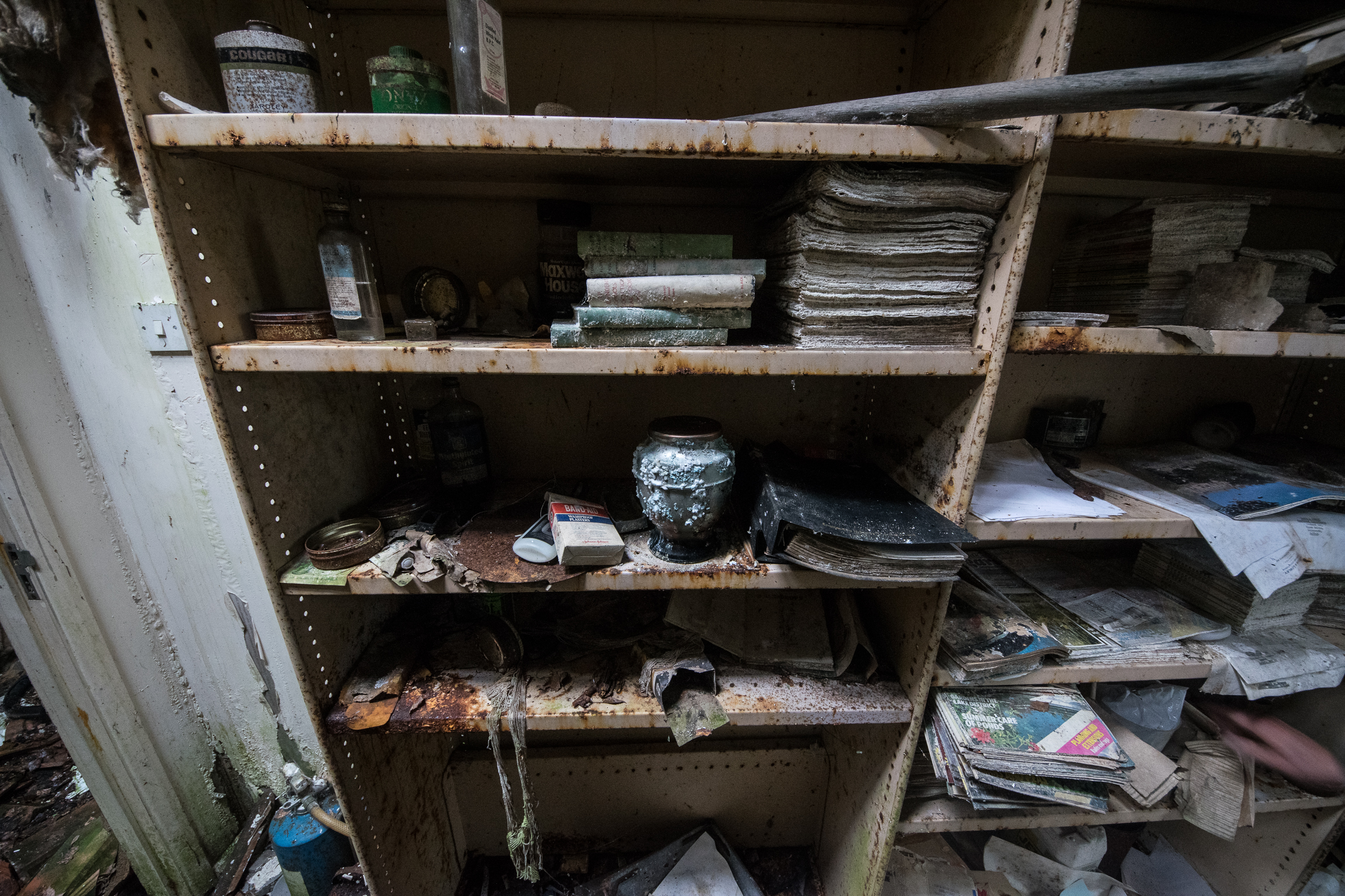 House Of The Cremation Ashes - This was an interesting little bungalow.First I came across the old false teeth of the owner and then discovered his ashy remains inside an urn left casually on a shelf amongst decaying books.So many personal belonging just left to rot in this one. Lovely to photograph