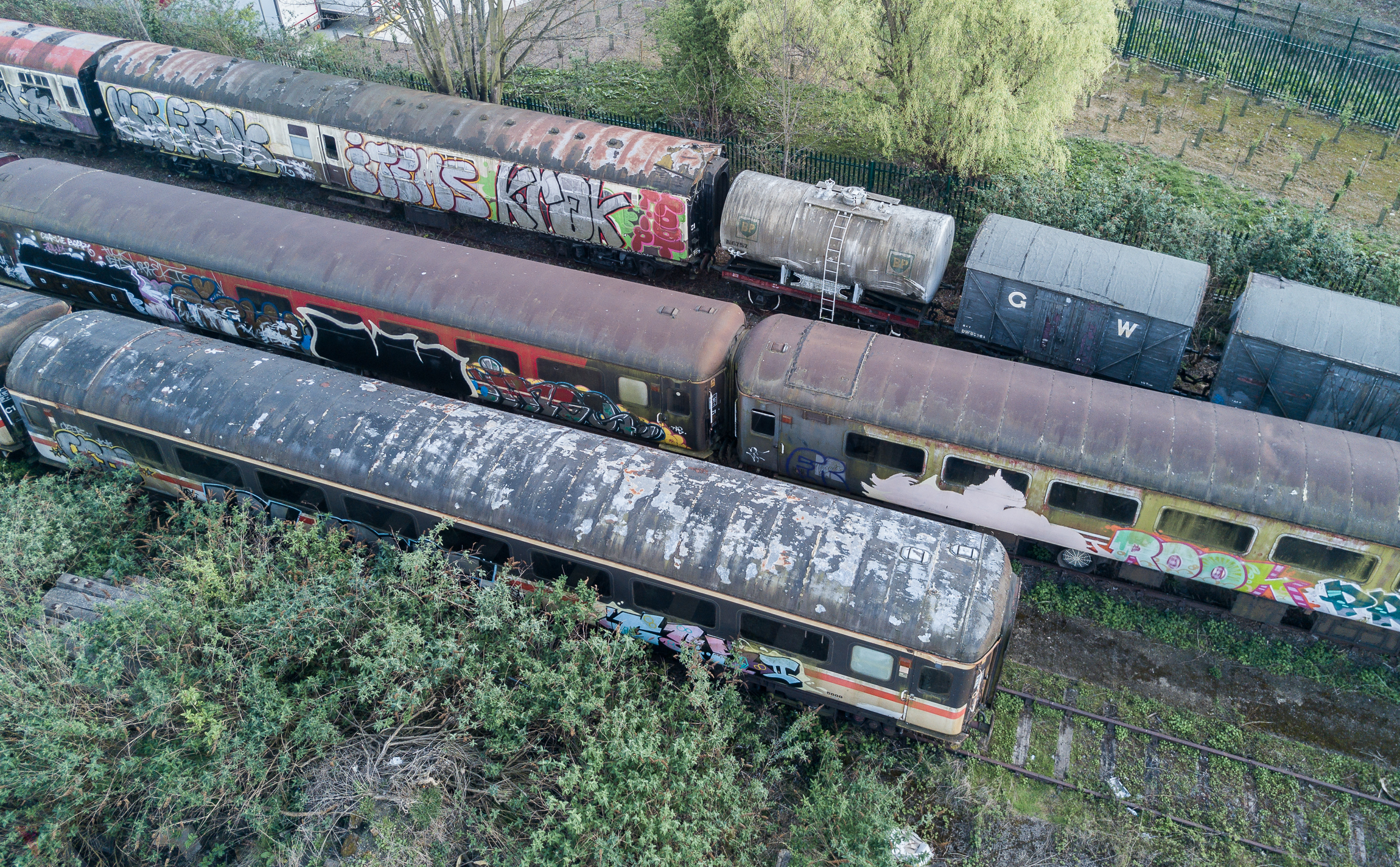 Unloved Trains - Rotting, smelly carriages, sitting wasted and pretty in a urban dump.
