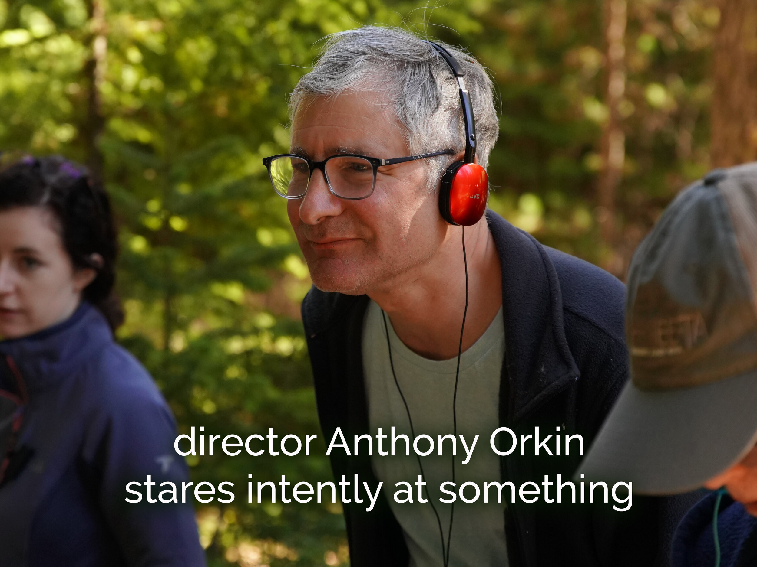 Director Anthony Orkin stares intently at something.JPG