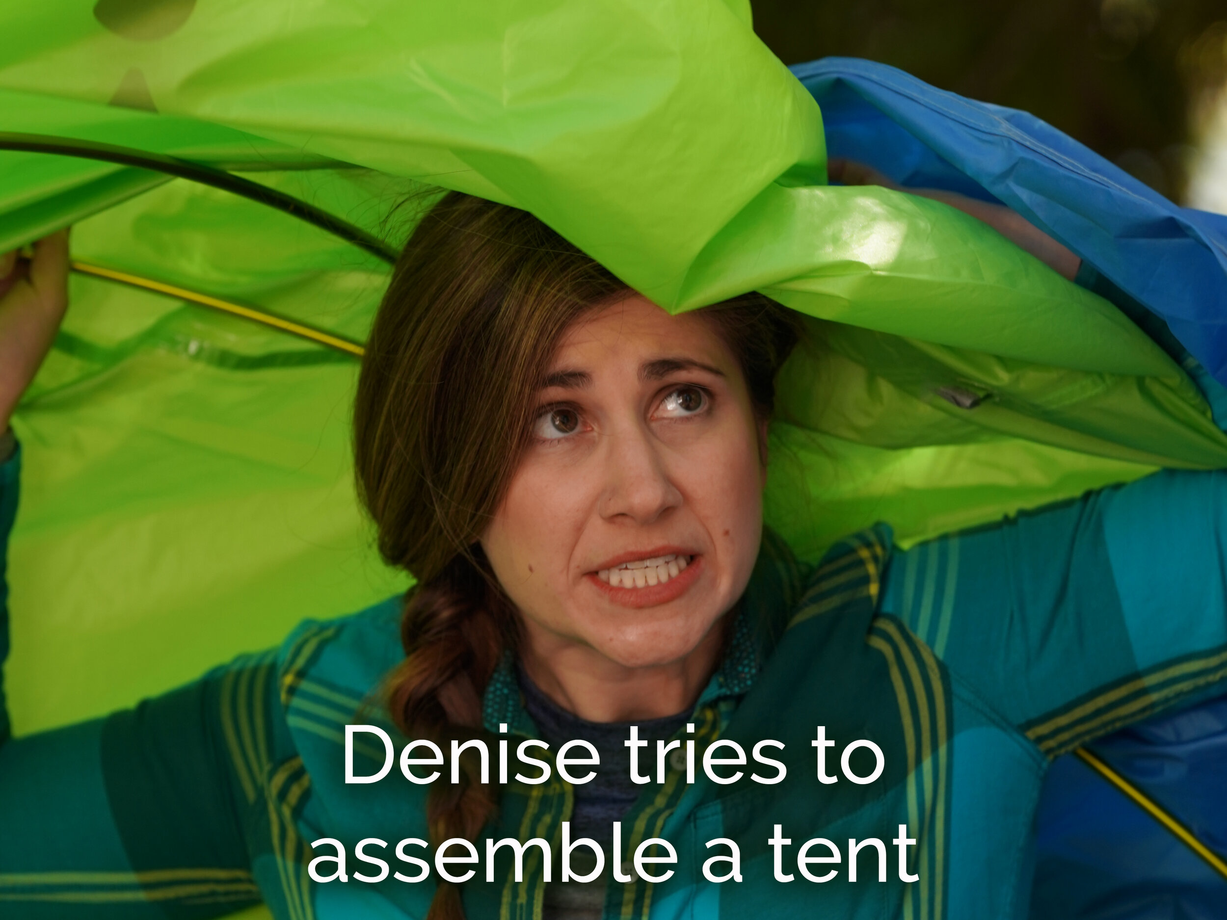 Denise tries to assemble a tent.JPG