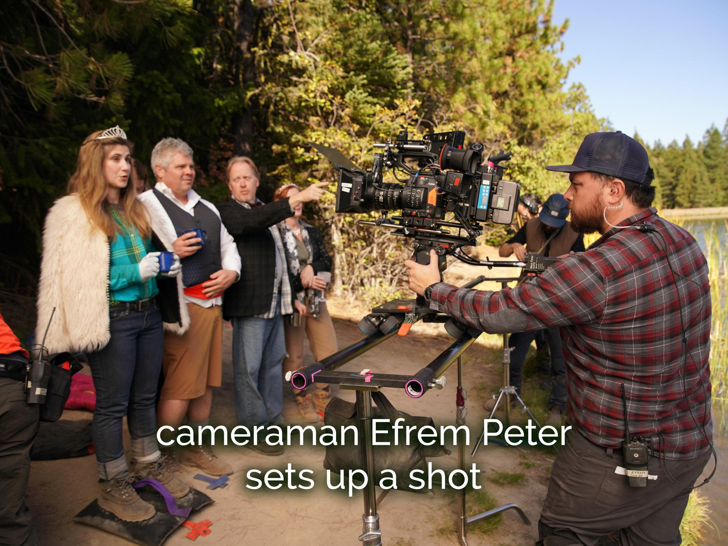 Cameraman Efrem Peters sets up a dolly shot.JPG