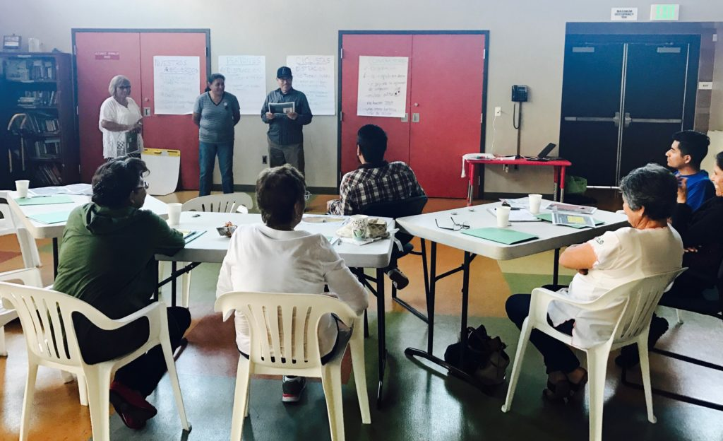 Santa Ana residents lead a presentation on safe mobility habits. Latino Health Access staff are training a team of residents to be safe mobility ambassadors in their community. Image: Latino Health Access