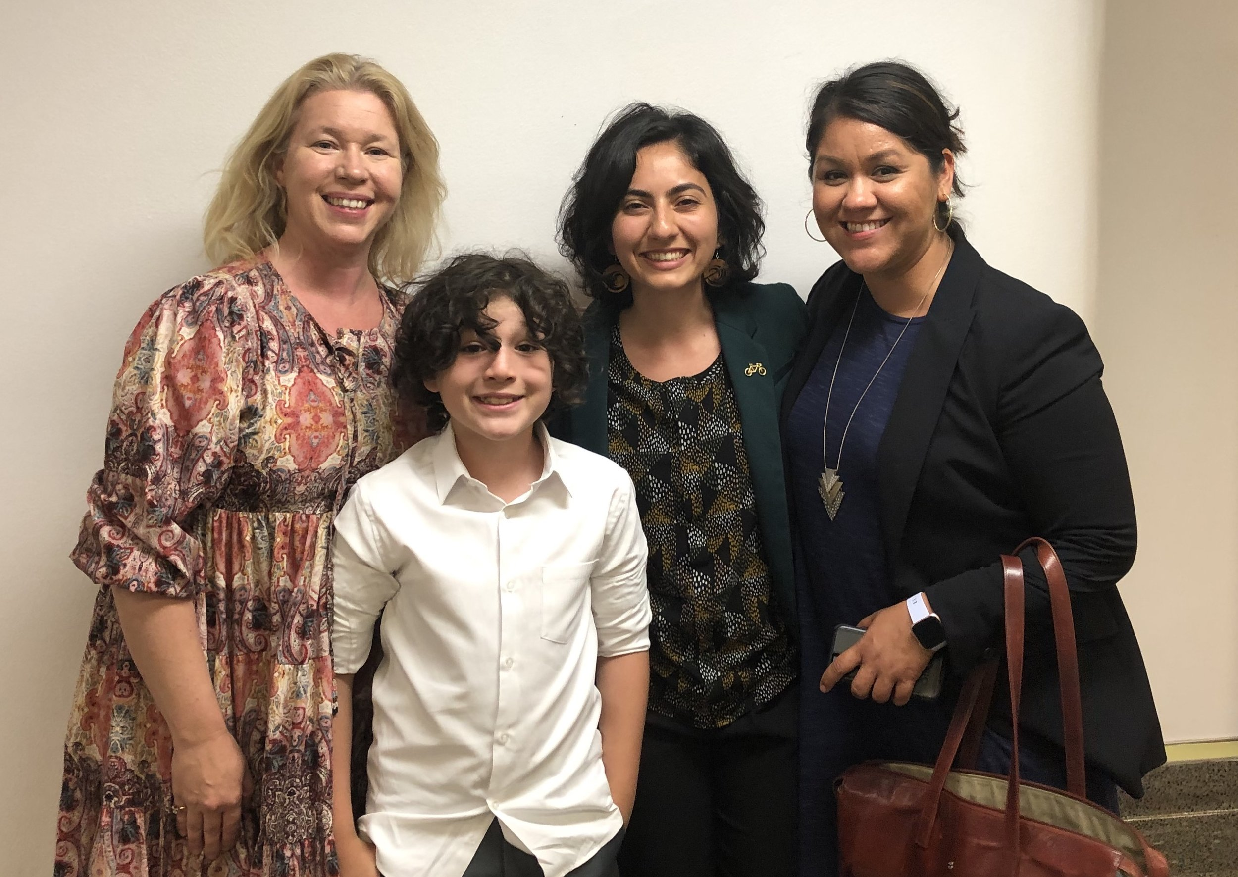 Cal Walks' Esther Rivera and CalBike's Linda Khamoushian celebrating with star witness Moses Trujillo (5th grader at Malcolm X Elementary School in Berkeley) and his mother after SB 127 passed out of the Assembly Transportation Committee.