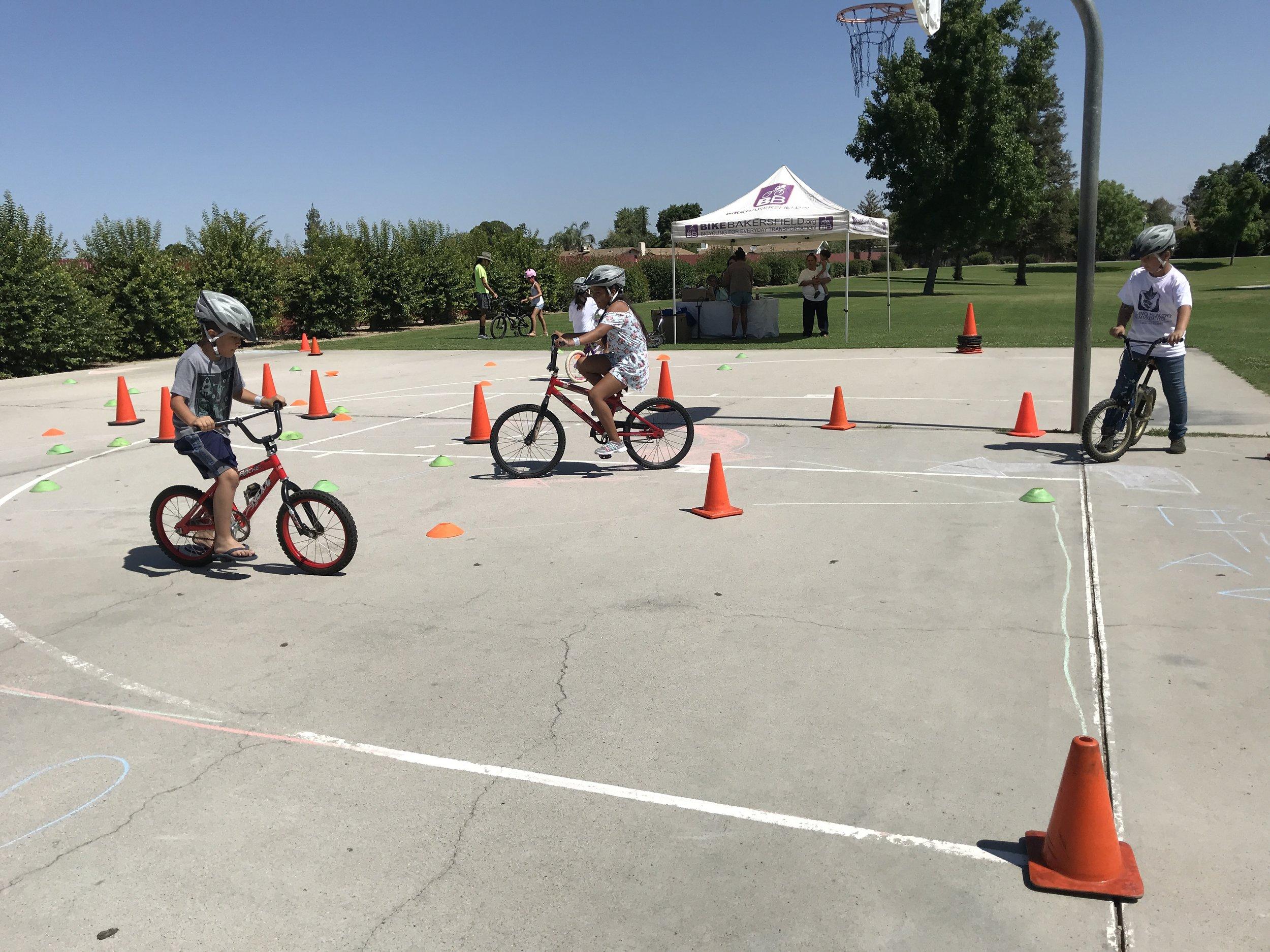 Bike Bakersfield teaching kids to ride bikes in Stiern Park.