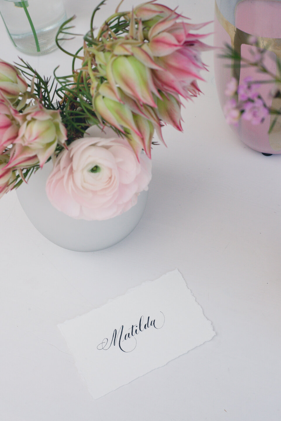 Simple white place card with Copperplate calligraphy (Patricia style).