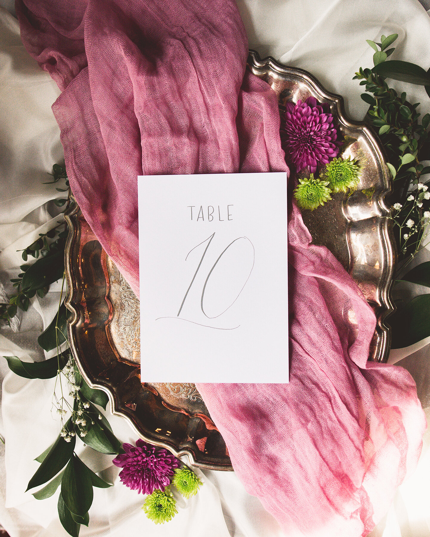 Simple and elegant white table numbers with gray ink