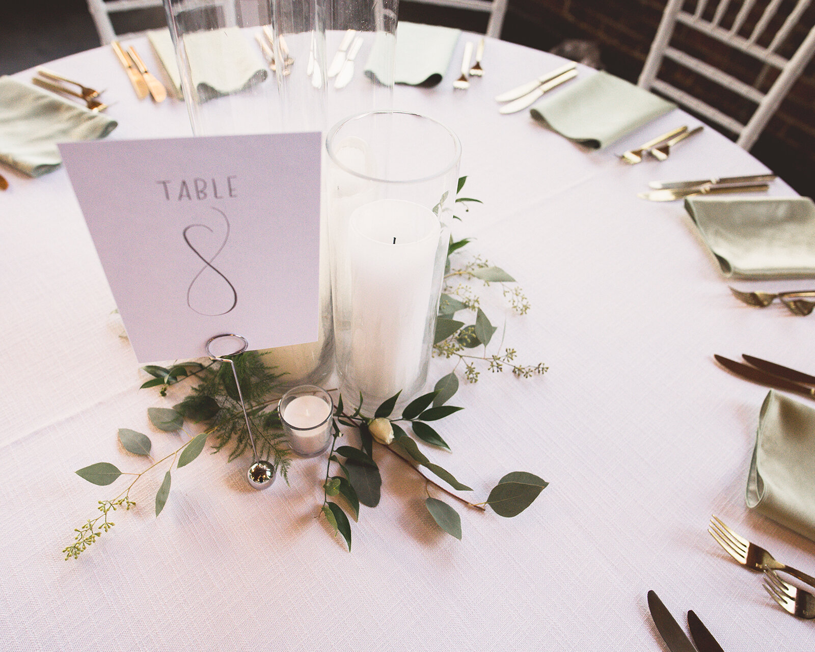 Simple and elegant white table numbers with gray ink.