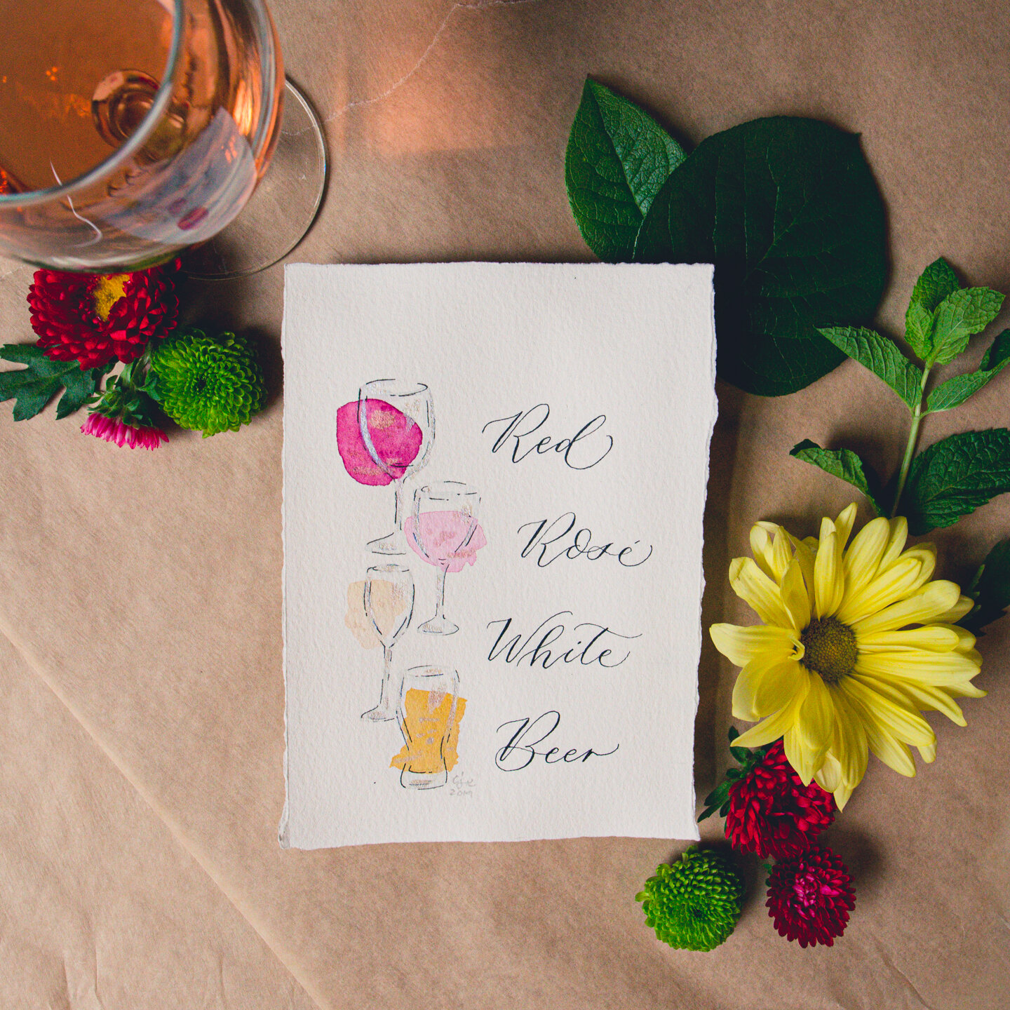 Hand painted wine menu with watercolors and modern calligraphy