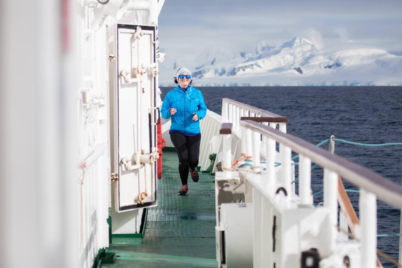 woman running ship deck antarctic marathon training