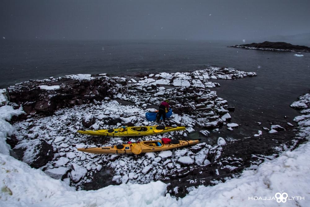 people getting kayaks ready antarctica ice