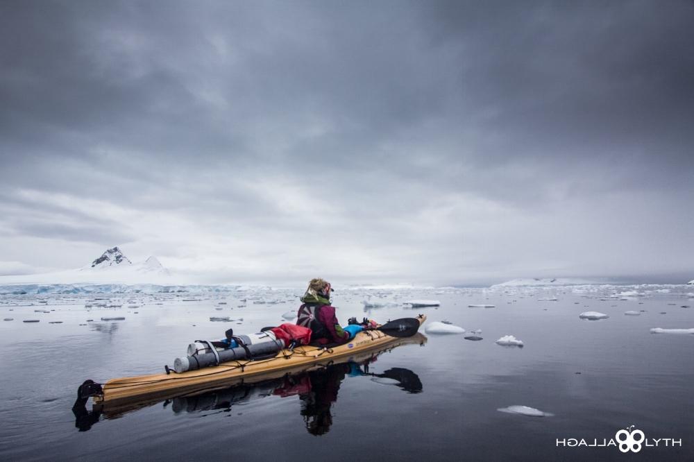 woman kayaking antarctica ice