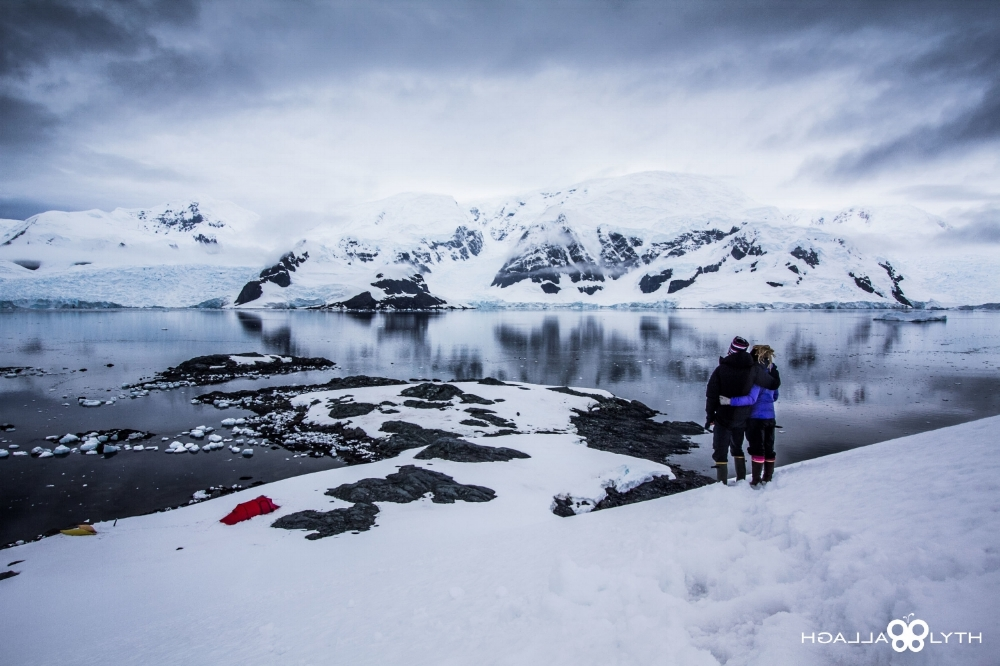 two people standing antarctica camping outdoors