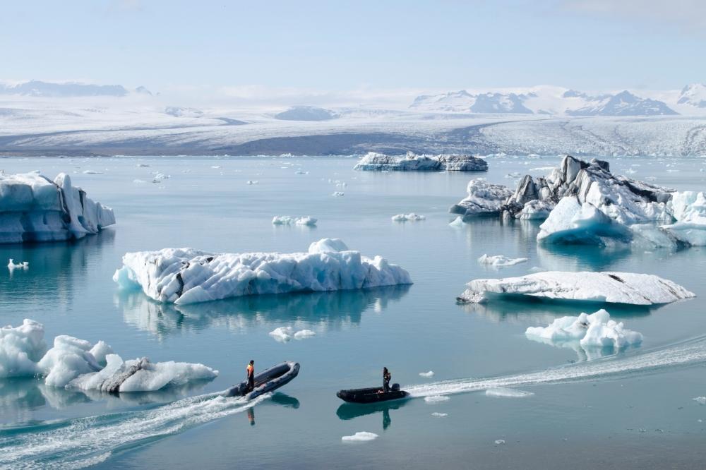 two zodiacs in antarctica icebergs