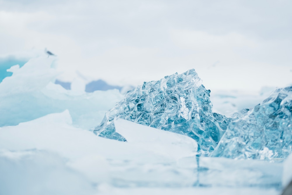 Clear ice with blue and white hues up close by Jonas Jacobsson