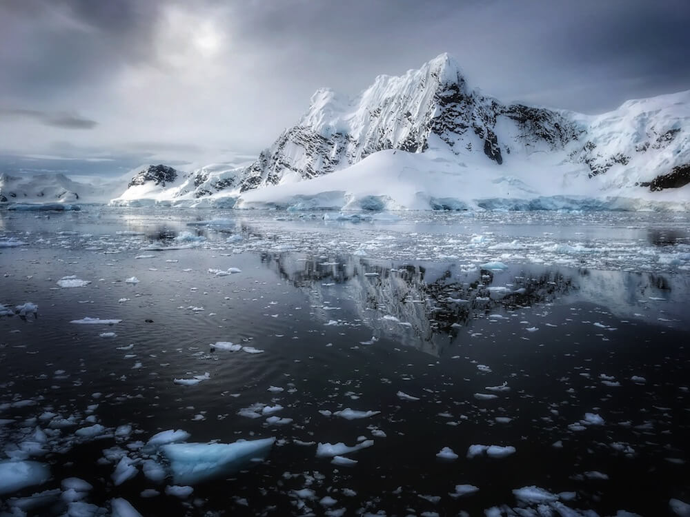 Antarctica landscape mountains snow ice ocean.