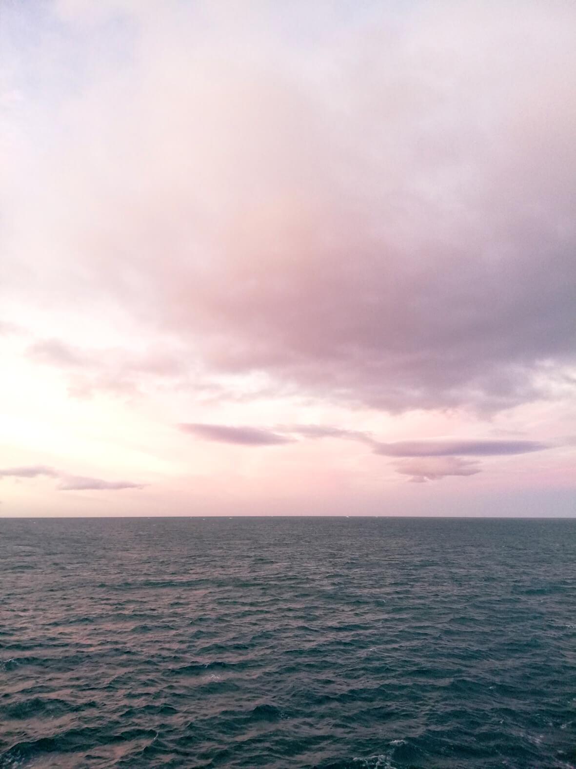 calm ocean pink sky high arctic
