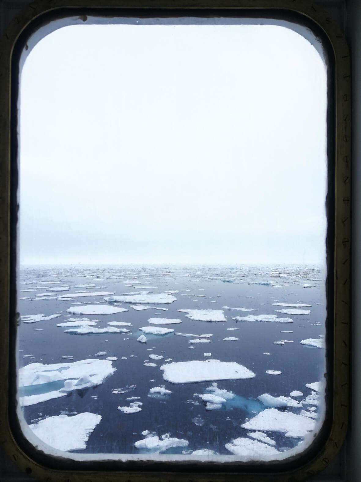 sea ice through a ship window in the high arctic