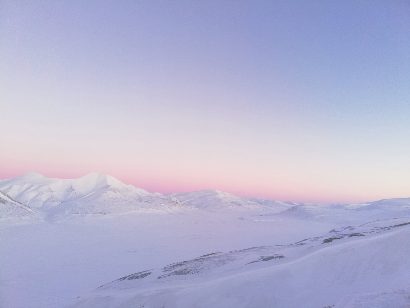 high arctic landscape pink and white sky