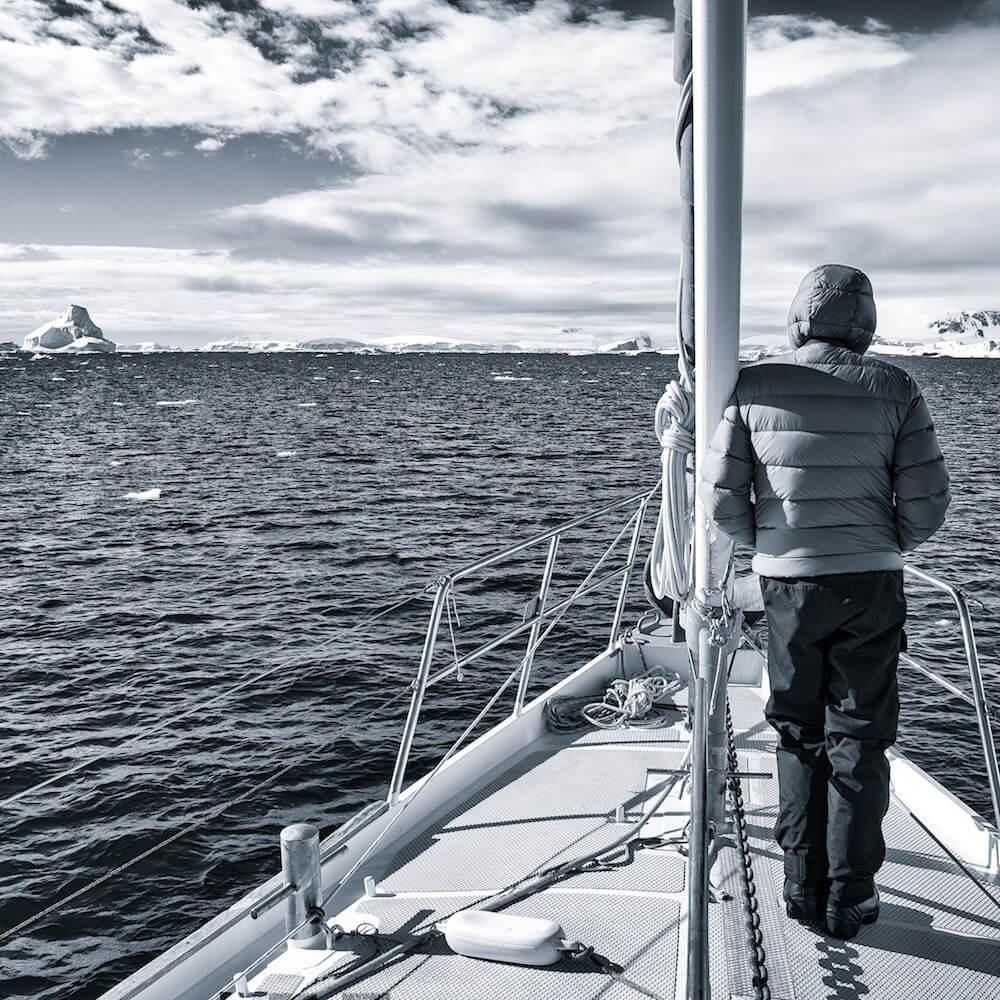 man on sailboat in antarctica cyanotype image christophe ngo