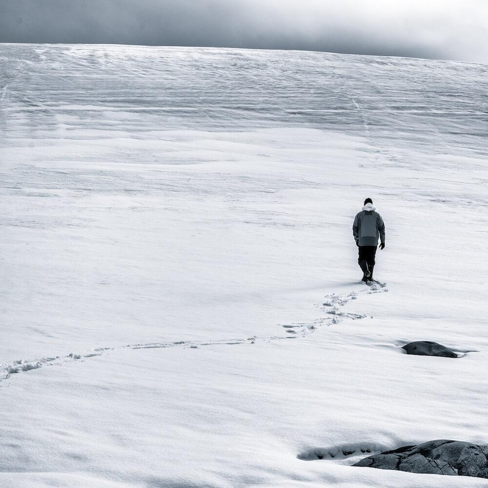 man walking on ice antarctica cyanotype image christophe ngo