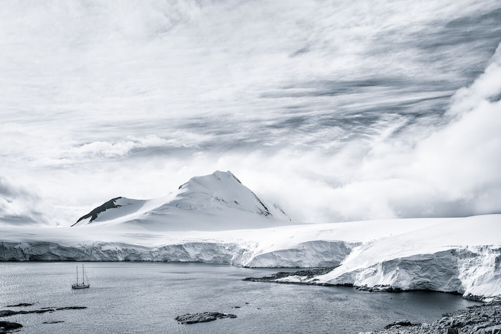 landscape cyanotype image of a sailboat in antarctica christophe ngo