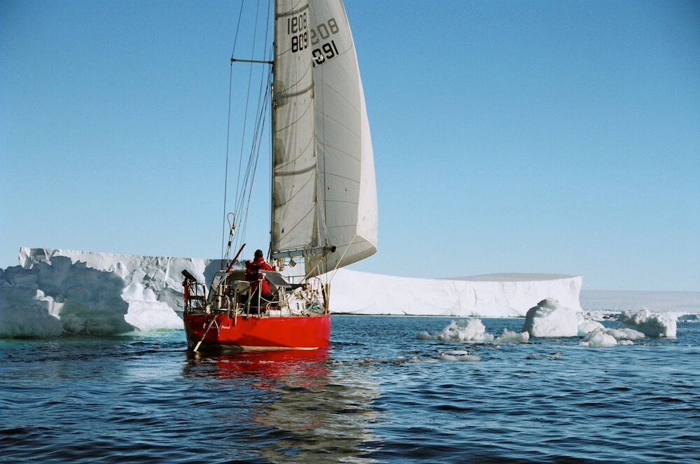 Sailboat in Antarctica icebergs