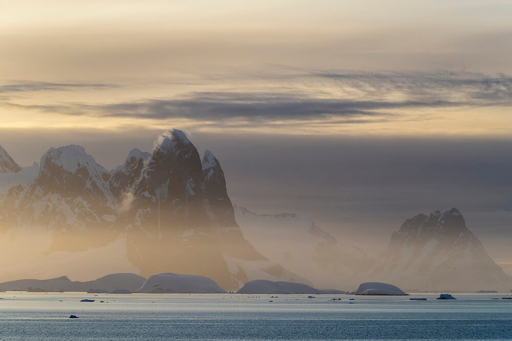 Sunset on the Lemaire Channel in Antarctica, a small strip of open water that lies between the Kiev Peninsula and Booth Island, once described as a 'Kodak Gap'.