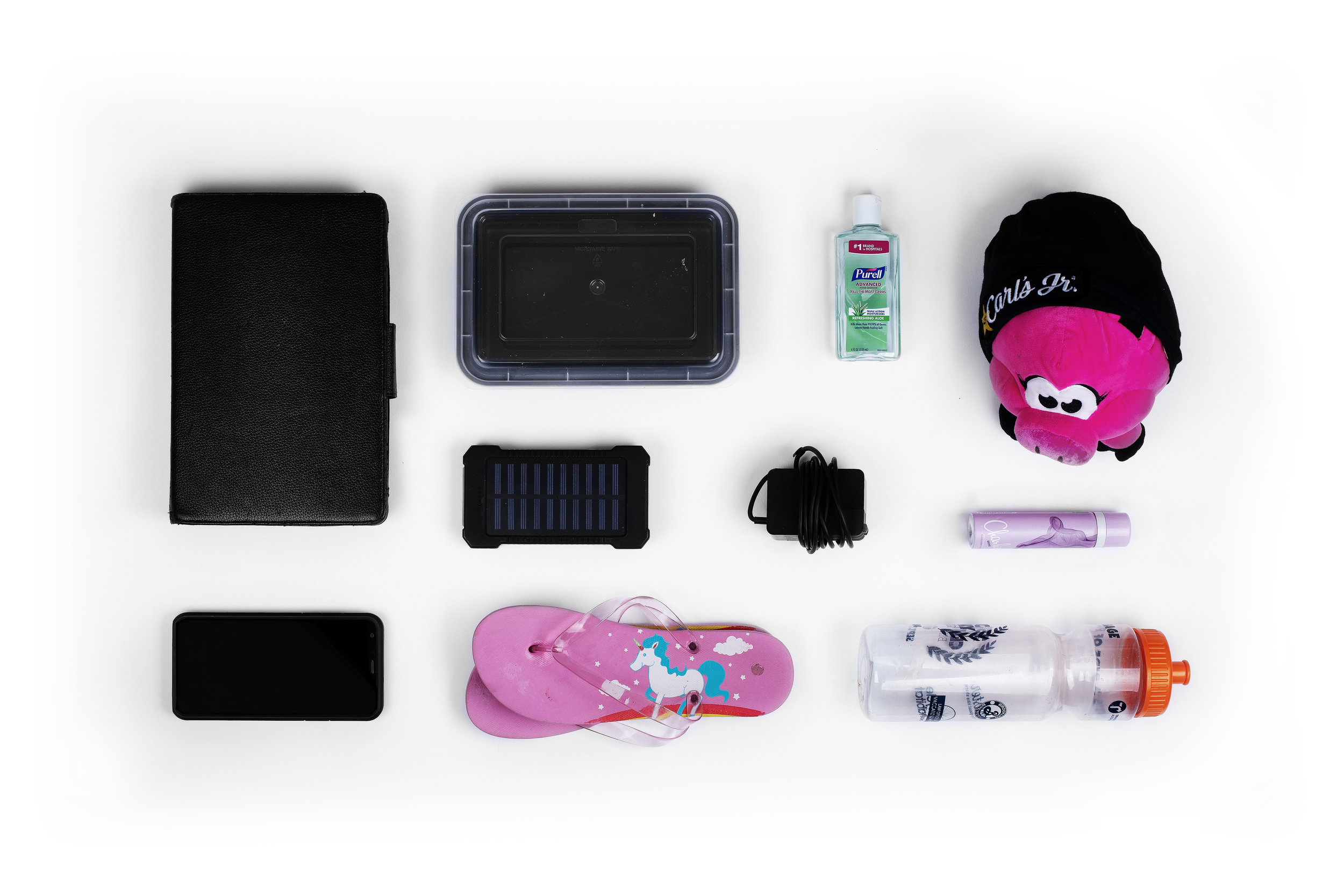 Tablet – Plastic Container – Purell – Plush Toy – Solar Charger – Charger – Perfume – Cell Phone – Flip Flops – Water Bottle