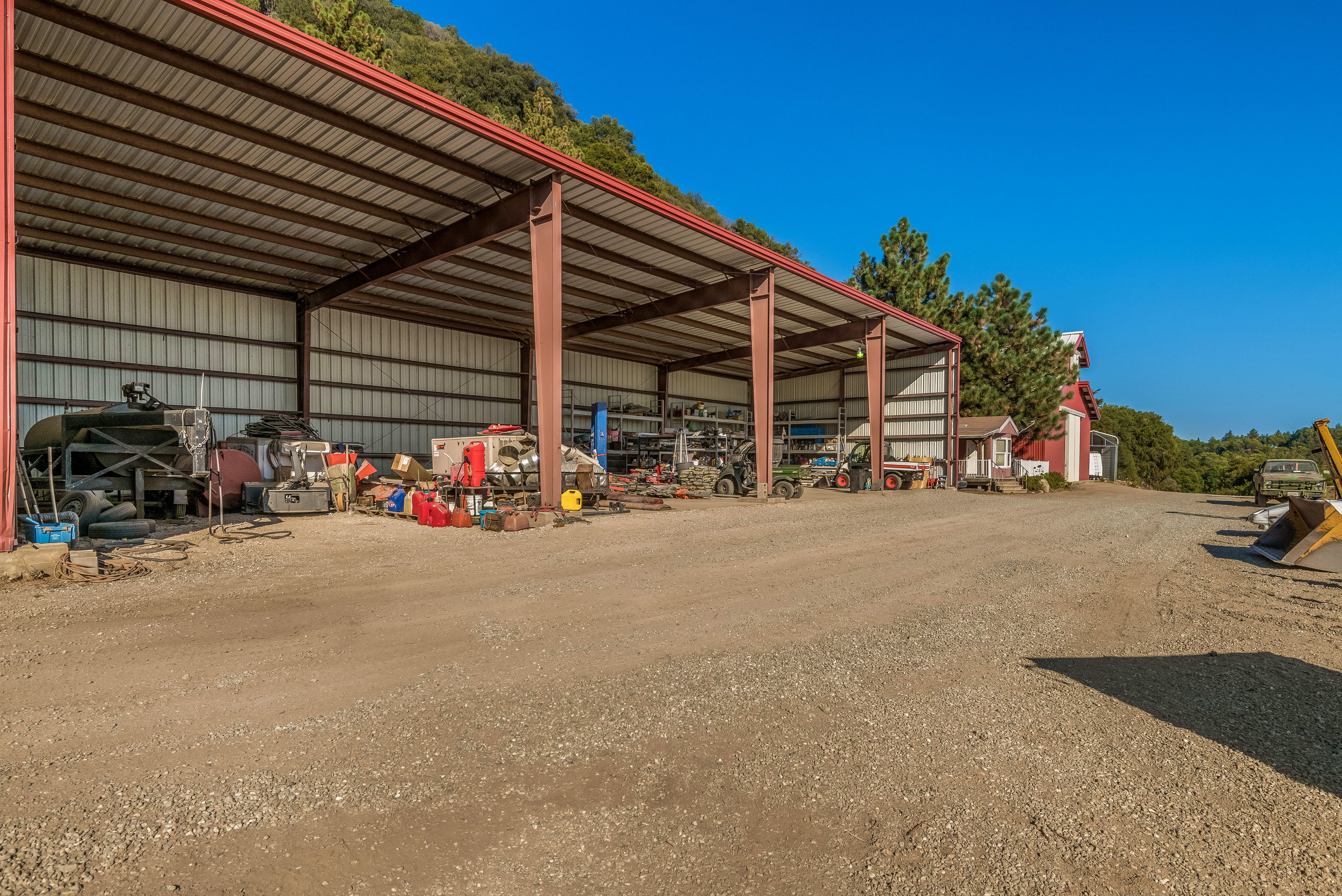 The Barns/ - Located on the Buffalo Ranch are two fully-functional barns: one for equipment and the other for storing hay. Multiple pieces of equipment are included in the offering, including several trailers, Toolcat Bobcat with a commercial snowblower, Kubota Tractor, John Deere 701 Backhoe and an operating firetruck.