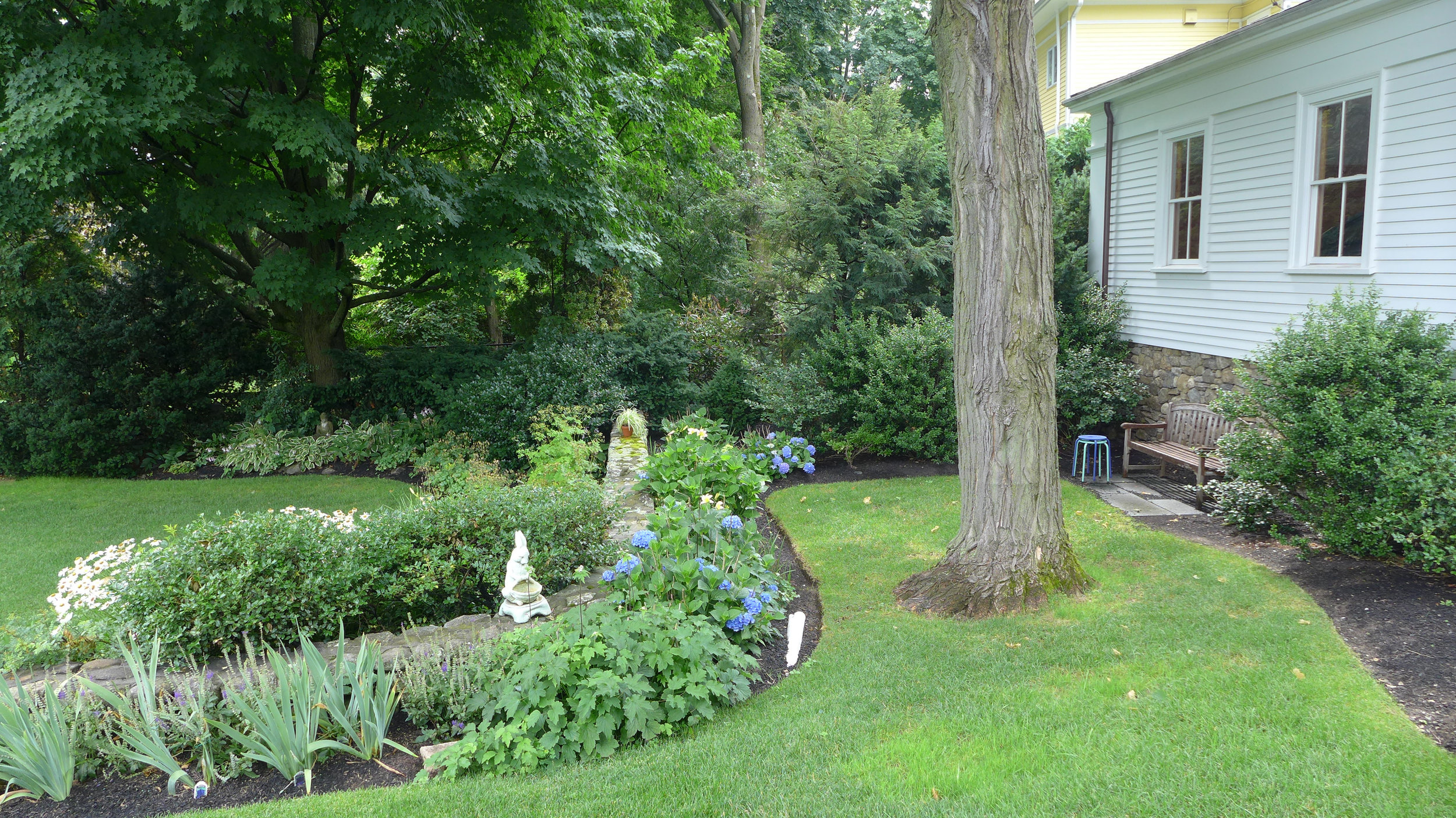 Bench #2 and view of yard with hydrangias.jpg