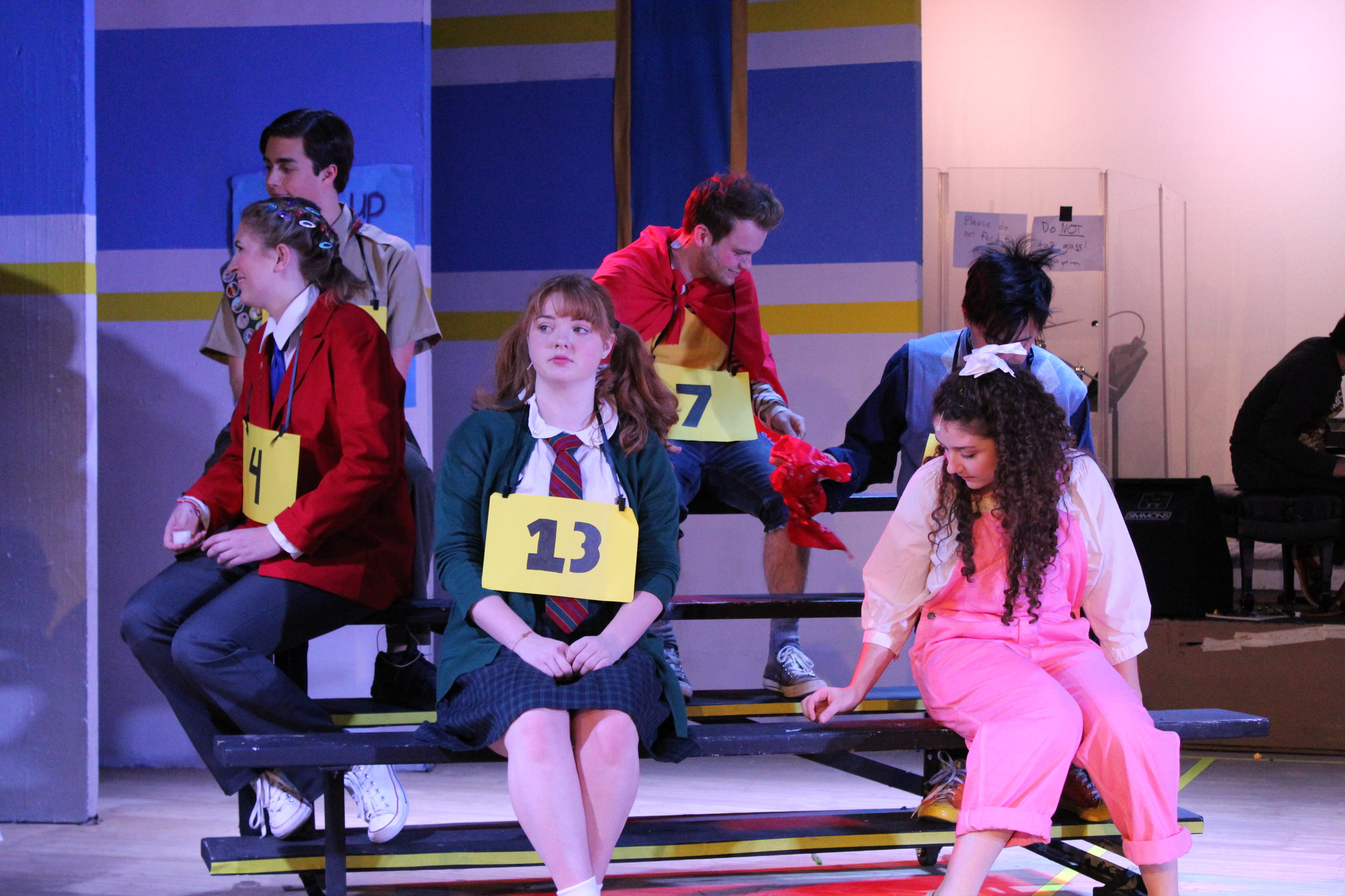 """The Spellers in """"The 25th Annual Putnam County Spelling Bee"""" await their next turn at the microphone. (Fall 2018)"""
