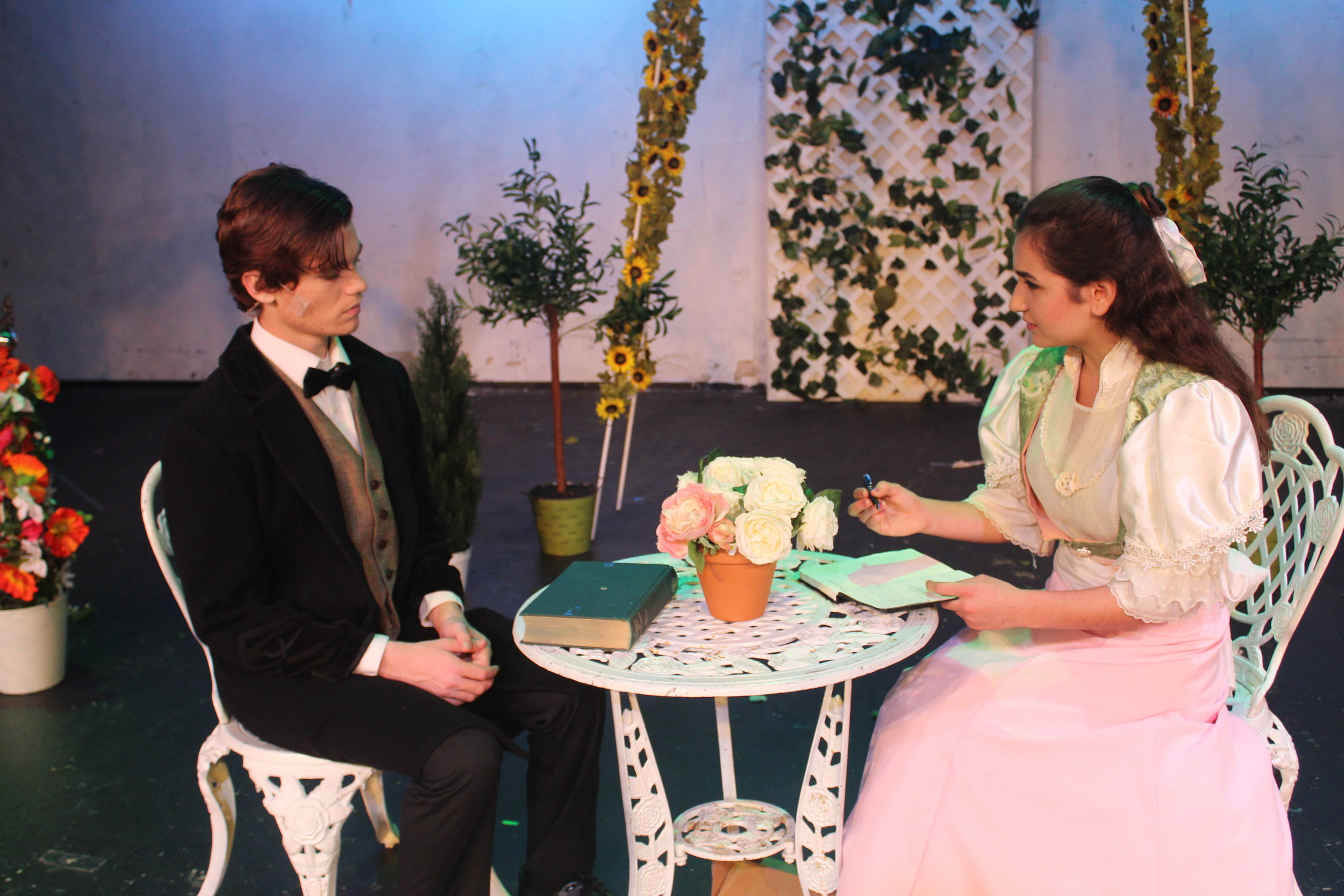 """Cecily and Algernon from """"The Importance of Being Earnest"""" spark the beginning of their romance. (Fall 2018)"""