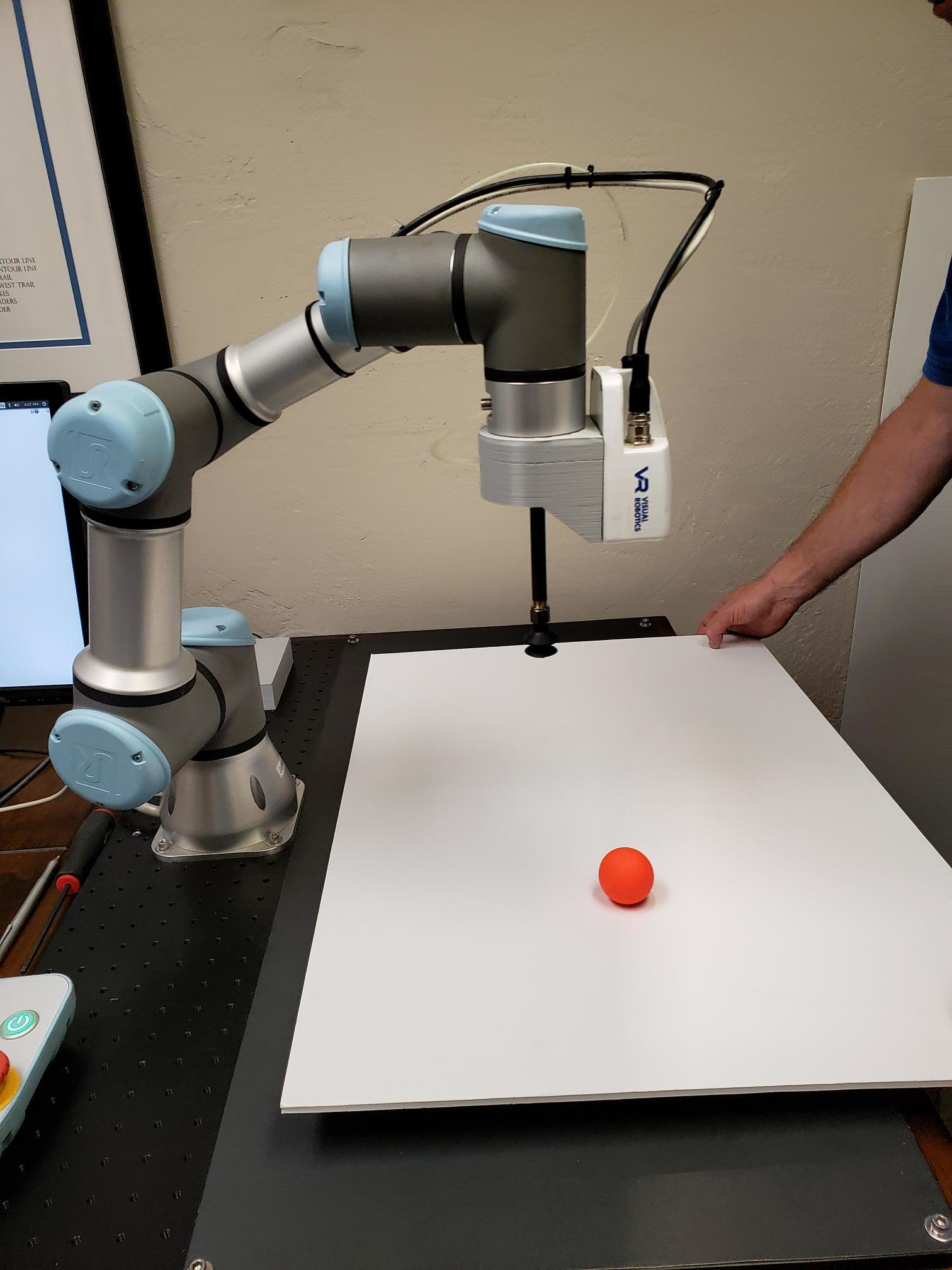 In this demonstration, a UR3 robot with our VIM-201 system installed moves in synch with a rolling golf ball. The vision system tracks the ball and sends updated way points to the robot continuously in order to maintain its relative position.