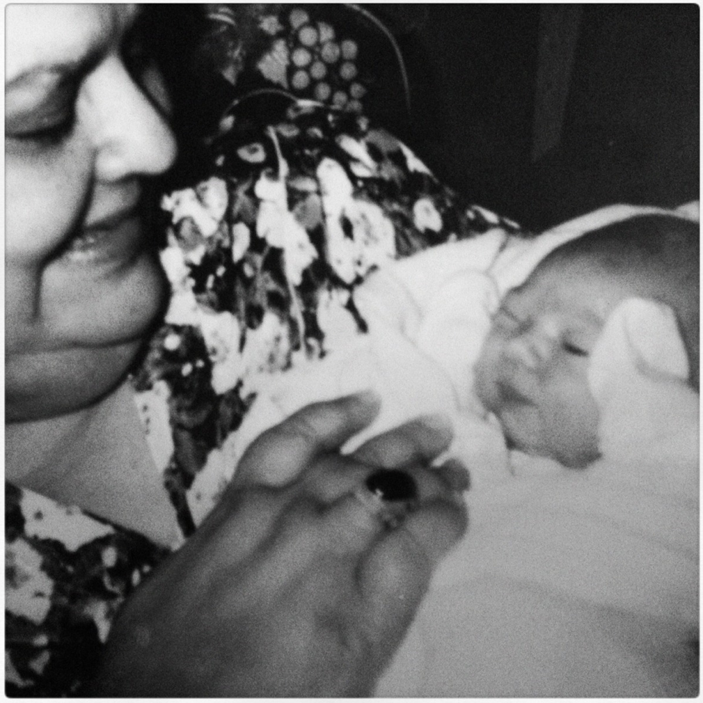 Me, 1 hour old, eyeing up my grandma's ring