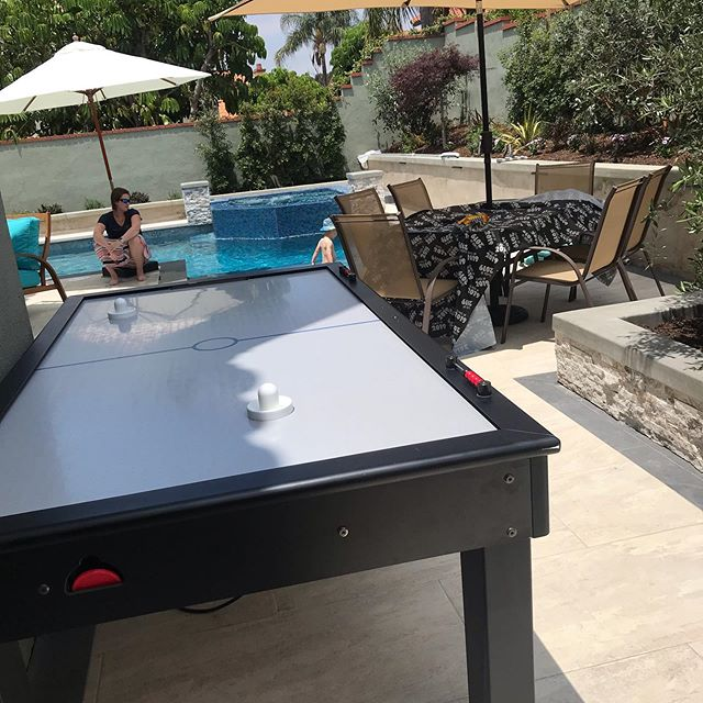 Graduation party.  Set up this air hockey table by the pool.  #graduation #graduationparty #event #eventplanner #party #partyplanner #weddingplanner