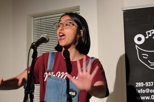 Robyn Sidhu performing a spoken word piece in Burlington.  Photo courtesy of Dee Duward.